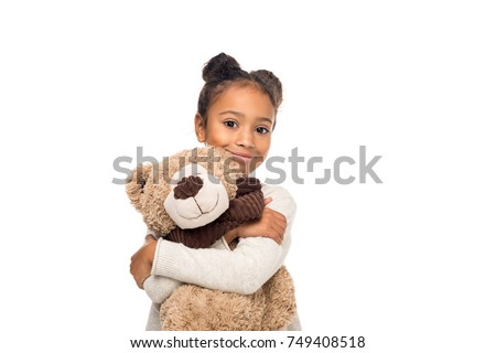 beautiful african american child hugging teddy bear and smiling at camera isolated on white #749408518