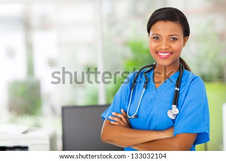 beautiful african american female pediatric nurse in modern office