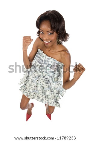 Beautiful African american girl dressed entirely in dollars