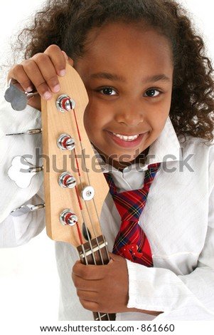 Beautiful African American girl holding a bass guitar.