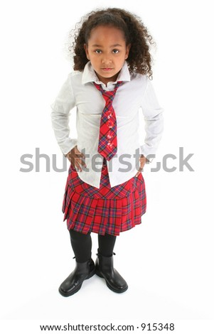 Beautiful African American girl in a plaid skirt and tie and a white shirt.