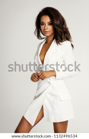 Beautiful african american girl in white clothes #1132496534