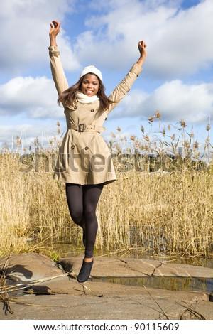 Beautiful african american girl jumping in air