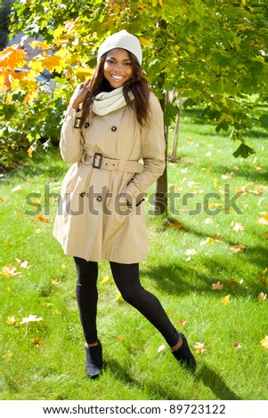 Beautiful african american girl smiling in park on autumn