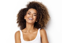 Beautiful african american girl with an afro hairstyle smiling