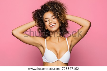 Beautiful african american girl with an afro hairstyle smiling #728897152