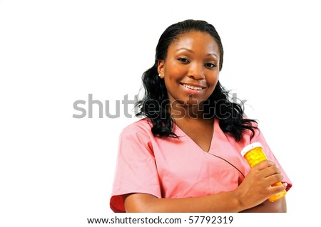Beautiful African American healthcare professional in pink scrubs - holding pill bottle