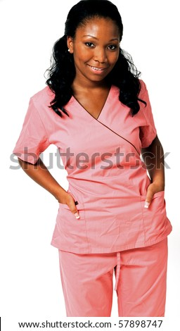 Beautiful African-American medical professional in pink scrubs smiling with hands in pockets