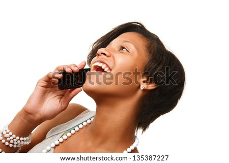 Beautiful African American teenage girl talking on cell phone, isolated on white.