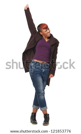 Beautiful African American woman dancer enjoying the music. Her hand is raised and she is isolated on white background