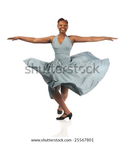 Beautiful African American woman dancing with dress blowing