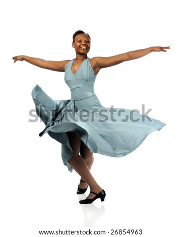 Beautiful African American woman dancing with dress blowing over white background