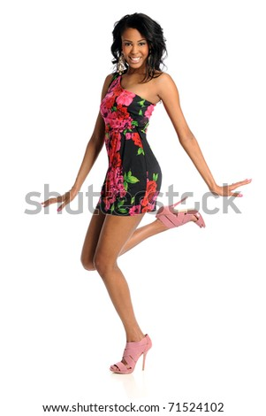 Beautiful African American woman jumping isolated over white background