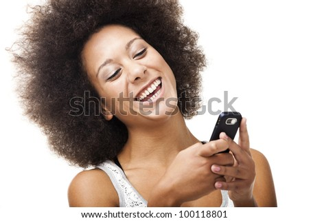 Beautiful African American woman sending a sms on cell phone, isolated on white background