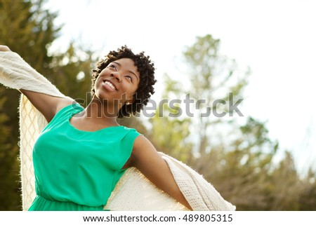 Beautiful African american woman smiling.
