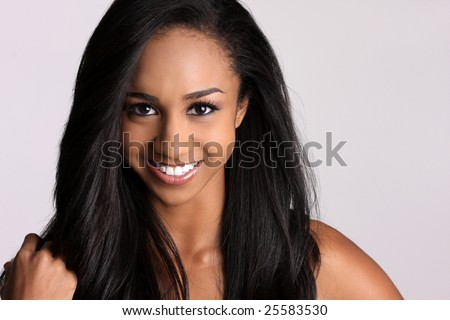 beautiful African-american woman with a broad smile and pretty black hair.