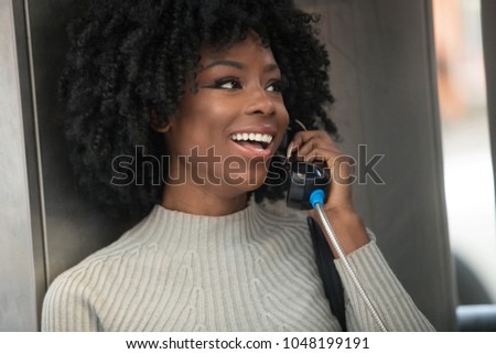 Beautiful African American Woman with Black Curly Hair #1048199191