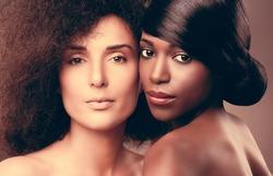 Beautiful african and caucasian women posing.