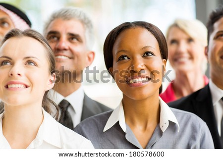 beautiful african businesswoman with colleagues looking up