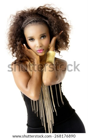 Beautiful African Female Model with Hands in Hair,  Afro Hairstyle, Wearing Tight Black Clothes, and Golden Jewellery, Isolated on White Background