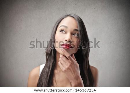 beautiful african girl thinks