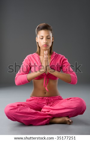Beautiful african woman doing some meditation