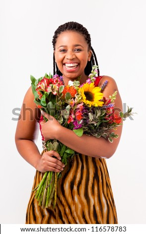 Beautiful African woman holding flowers on an isolated background