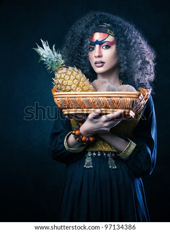 beautiful African woman with a basket of fruit