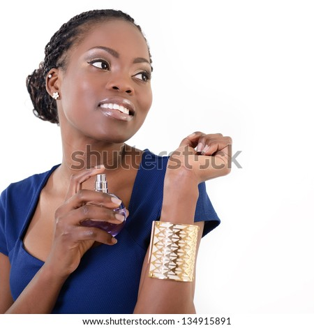 Beautiful african woman with perfume, young cheerful girl holding bottle of perfume and smelling aroma, over white background
