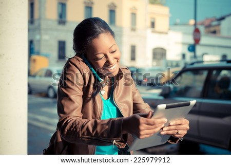 beautiful african young woman using smart phone in the city Stock photo ©