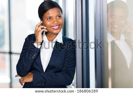 beautiful afro American businesswoman talking on a cell phone