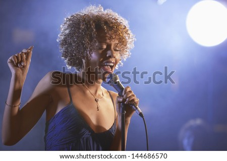 Beautiful Afro American jazz singer on stage