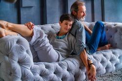 beautiful aged couple sitting on the sofa