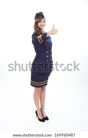 Beautiful air hostess showing thumb up gesture isolated on white background