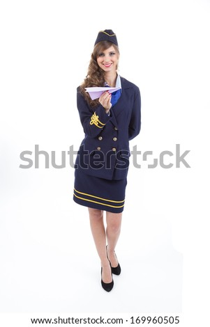 Beautiful air hostess with a paper airplane isolated on white background