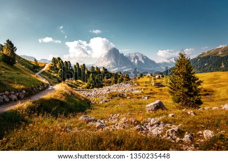 Beautiful alpine countryside. Awesome Alpine landscape with traditional huts. Amazing Nature Scenery of Dolomites Alps. Epic Scene in the mountains place near Seceda peak. Val Gardena. Dolomiti alp. #1350235448