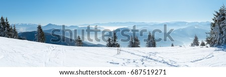 Beautiful  alpine panoramic view snow capped mountains, European beautiful winter mountains in Alps, Slope for cross country skiers in landscape #687519271