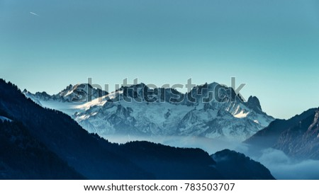 Beautiful alpine peaks view from the top over the clouds, natural landscape , Switzerland #783503707