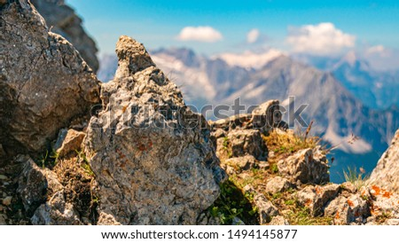 Beautiful alpine view at the famous Karwendel summit with the Zugspitze summit in the background near Mittenwald, Bavaria, Germany #1494145877