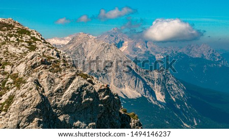 Beautiful alpine view at the famous Karwendel summit with the Zugspitze summit in the background near Mittenwald, Bavaria, Germany #1494146237