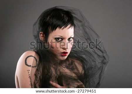 stock photo : Beautiful alternative girl with gothic hairstyle and makeup