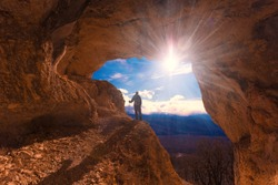 Beautiful amazing sunset.  Mountains in north country Russia Caucasus. Unique landscape mainsail.  Inspiring travel man. Old nature cave. Active sport hobby. Spelunking quest panorama.