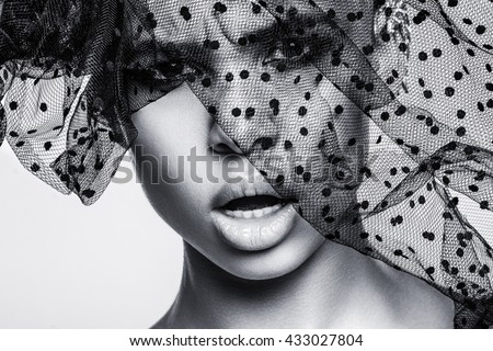 Beautiful american african girl posing. Woman with brown hair, black hat, dark skin. Attractive, sexy fashion model. Fashion shot in studio, on white background. Posing, make up, beauty, grid, veil. - Shutterstock ID 433027804
