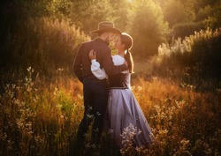 Beautiful American couple in autumn sunset