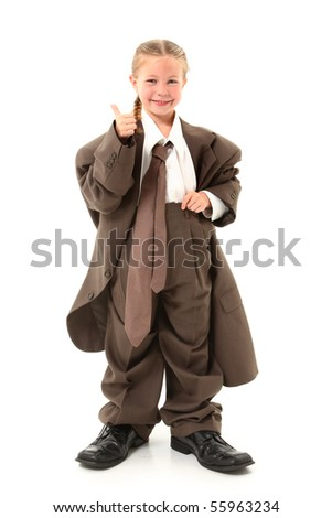 Beautiful  american four year old girl dressed in oversized business suit. - stock photo