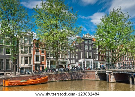Beautiful Amsterdam canals with typical houses