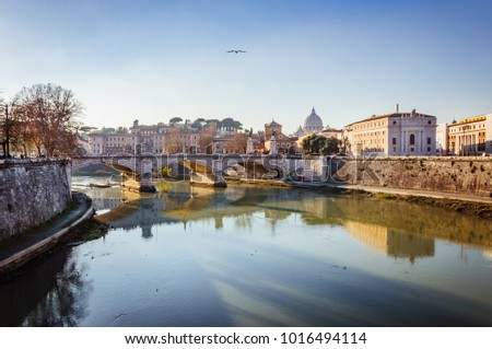 Beautiful ancient bridge over the calm river in the central part of Rome #1016494114
