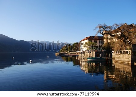 Beautiful ancient houses at sunset on Orta lake, Orta St. Giulio village, Piedmont, Italy