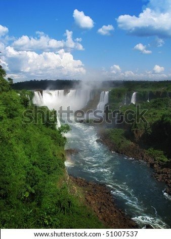 Beautiful and amazing Iguazu waterfalls on a sunny day, in Brazil.