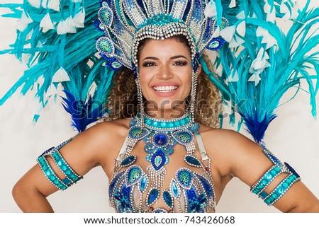 Beautiful and cheerful samba dancer portrait wearing blue traditional costume